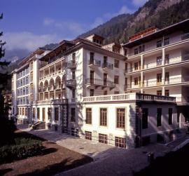 The Vallesana Centre, a Liberty-style building surrounded by mountain sceneries